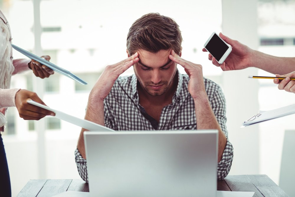 distracted man with no productivity in the workplace