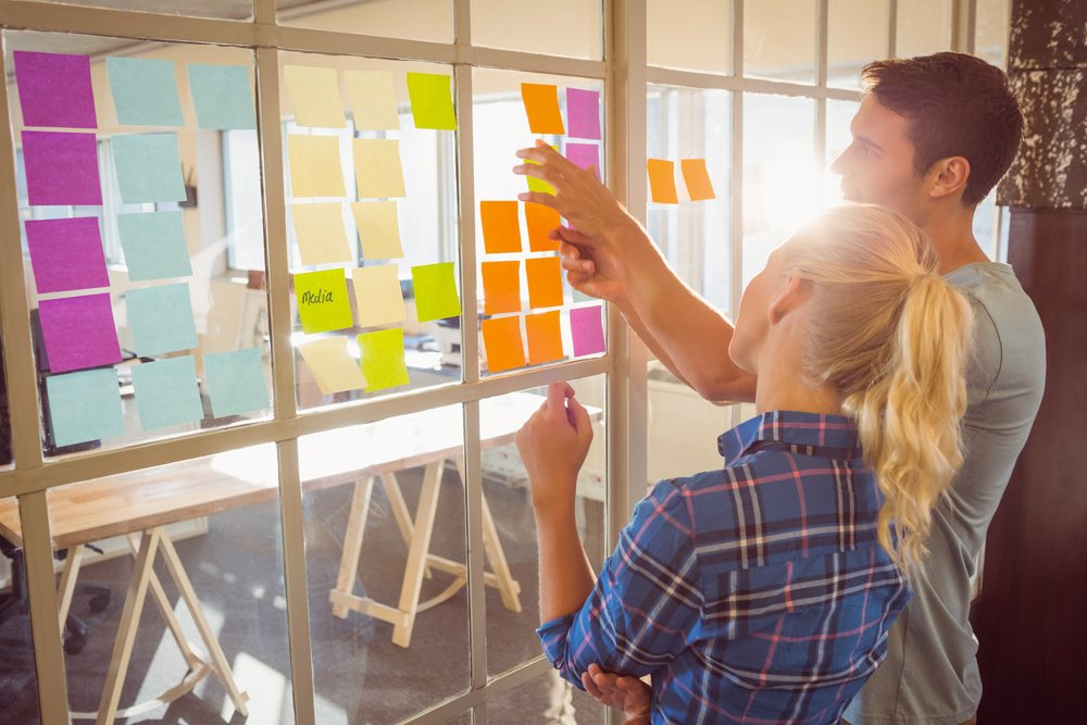 Young creative business people planning change control